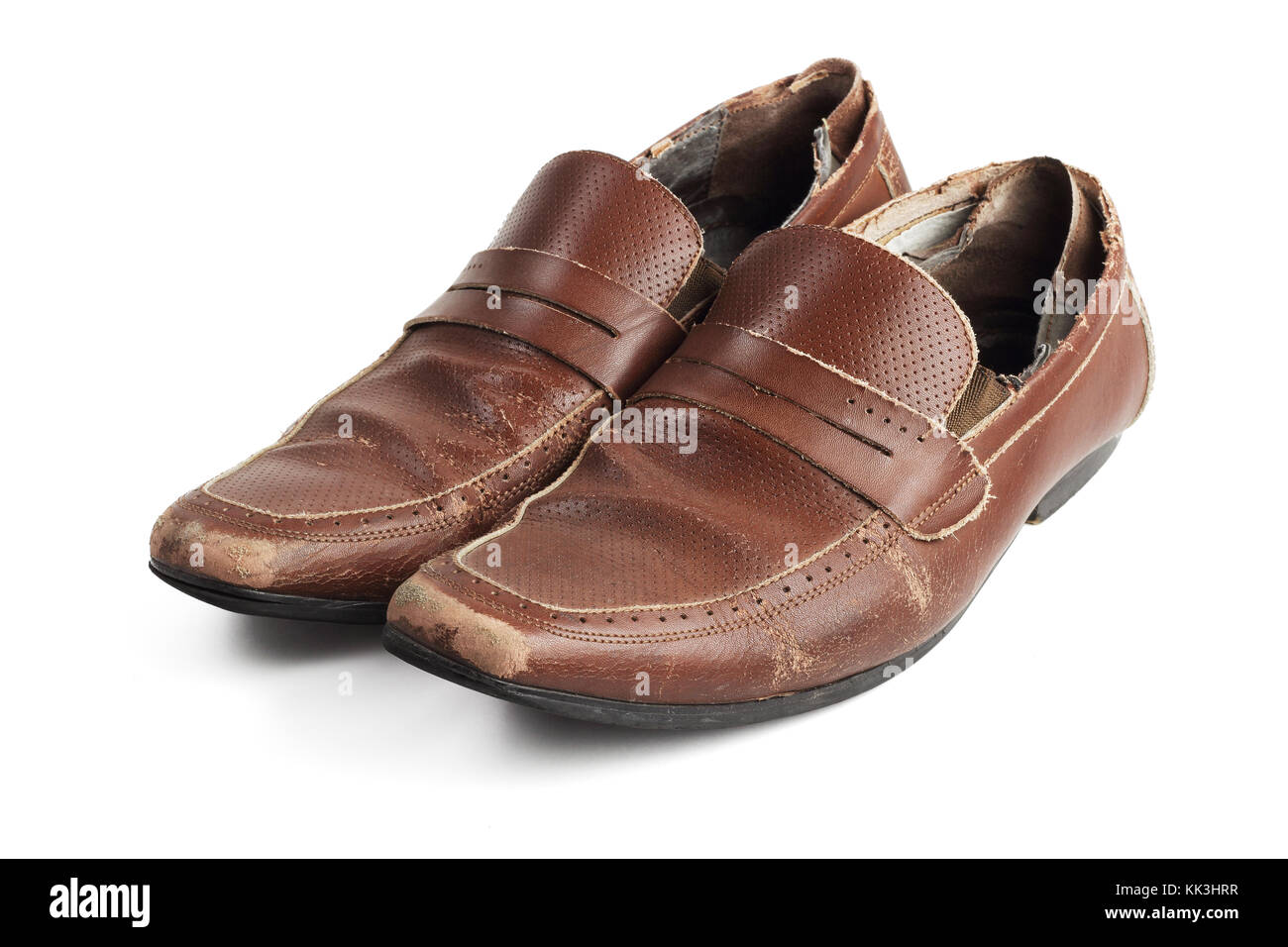 Old Pair of Used and Worn Brown Leather Shoes on White Background - Stock Image