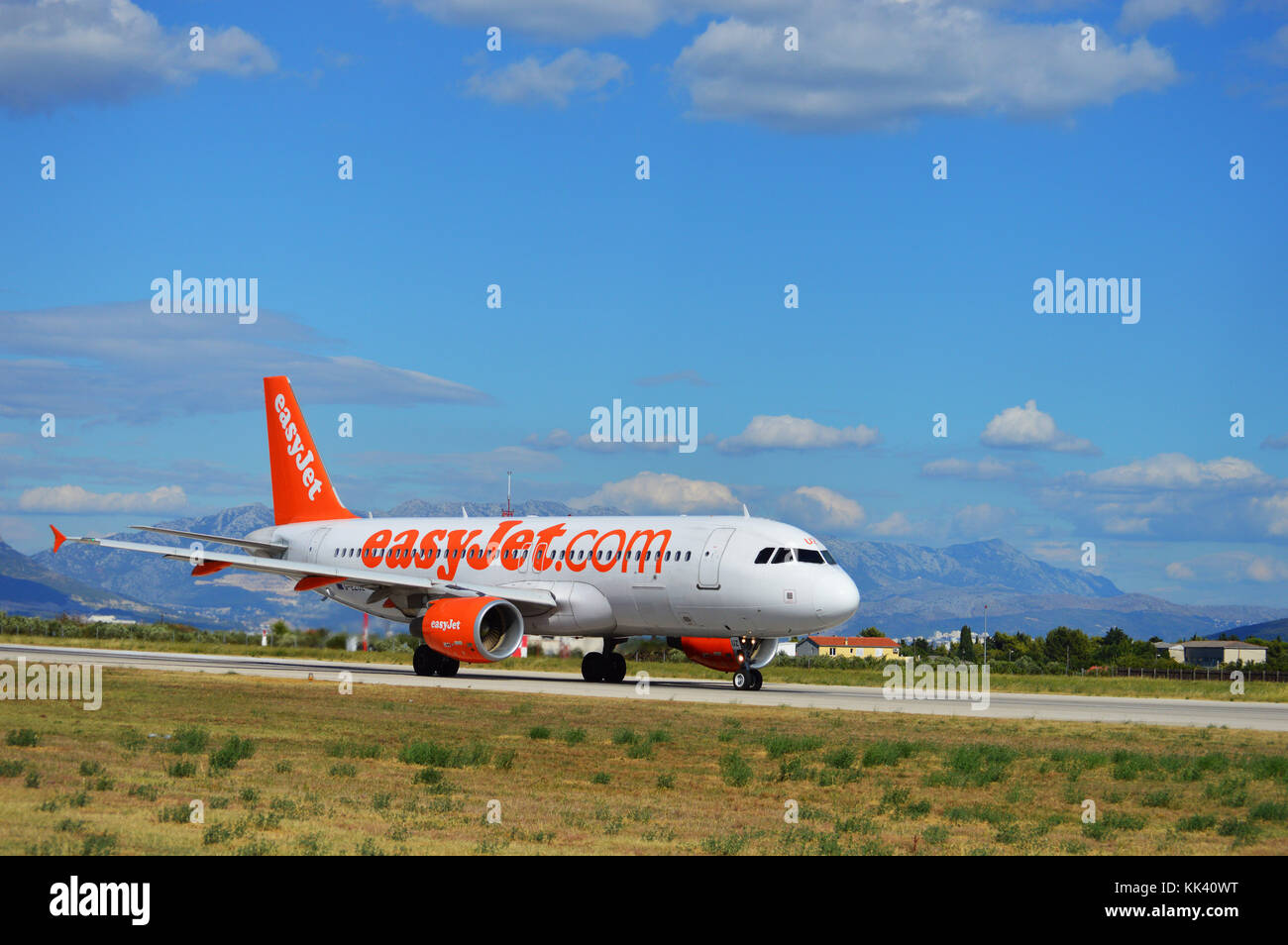 G-EZUZ  easyJet Airbus A320-214 taxiing the LDSP RWY 23 preparing for takeoff, Kaštela Croatia Stock Photo