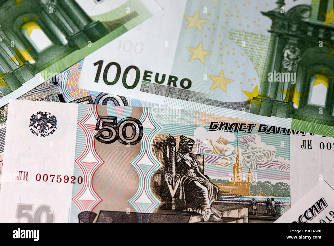 russian roubles and euro cash notes - Stock Image