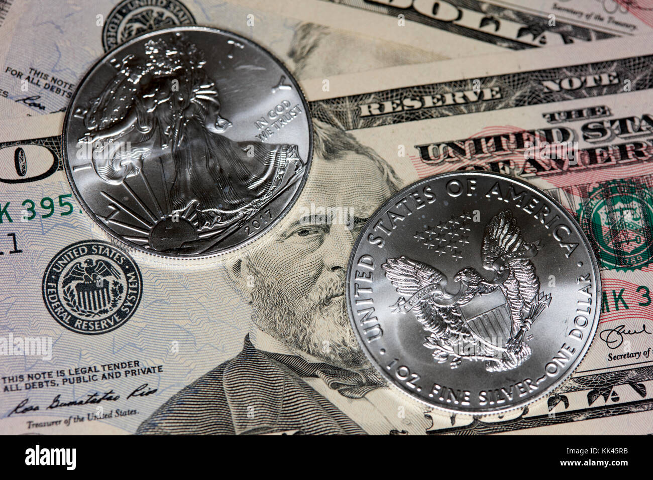 1oz silver bullion coins with us dollars cash banknotes - Stock Image