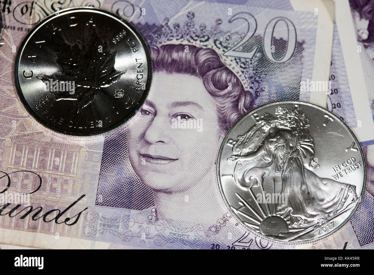 1oz silver bullion coins and british pounds - Stock Image