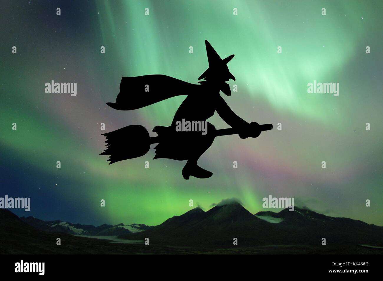 Graphic of a cartoon witch flying in front of Northern Lights observed during a solar storm which occurred on Halloween, - Stock Image