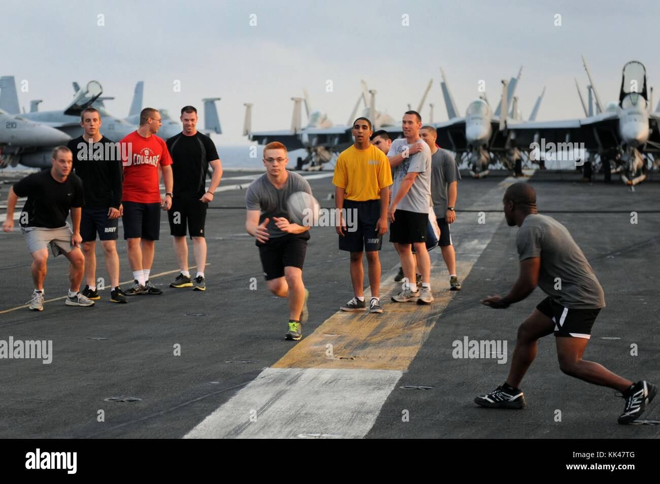The Nimitz-class aircraft carrier USS Dwight D Eisenhower's CVN 69 rugby team, the IKE Maulers, train on the flight Stock Photo