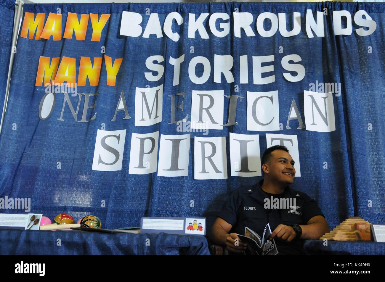 Aviation Machinist's Mate 3rd Class Edwin C Flores mans a booth showcasing hispanic culture during a diversity - Stock Image