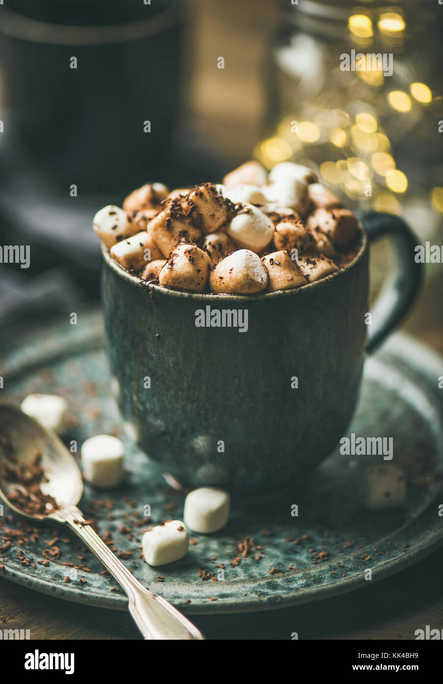 Winter warming sweet drink hot chocolate, Christmas lights behind - Stock Image