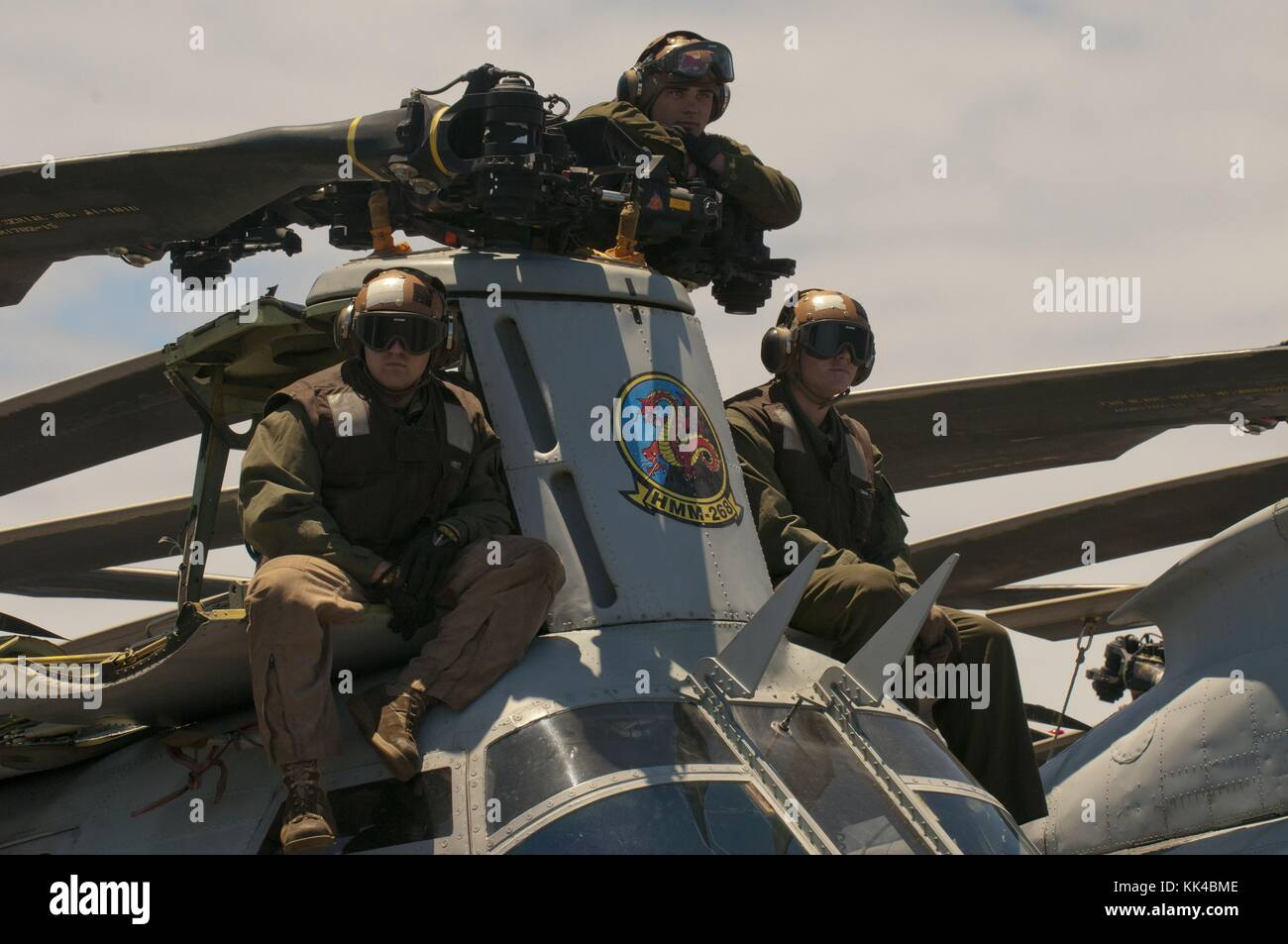 Marines assigned to the Red Dragons of Marine Medium Squadron HMM 268 view an air power demonstration from a CH - Stock Image