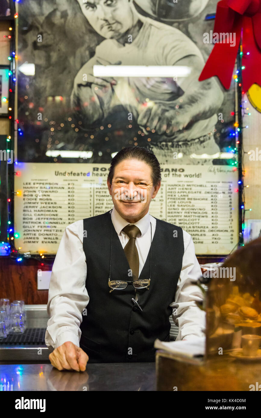 Friendly barman smiling, staff behind the counter at Bar Italia, Italian cafe and bar in Frith Street, Soho London - Stock Image