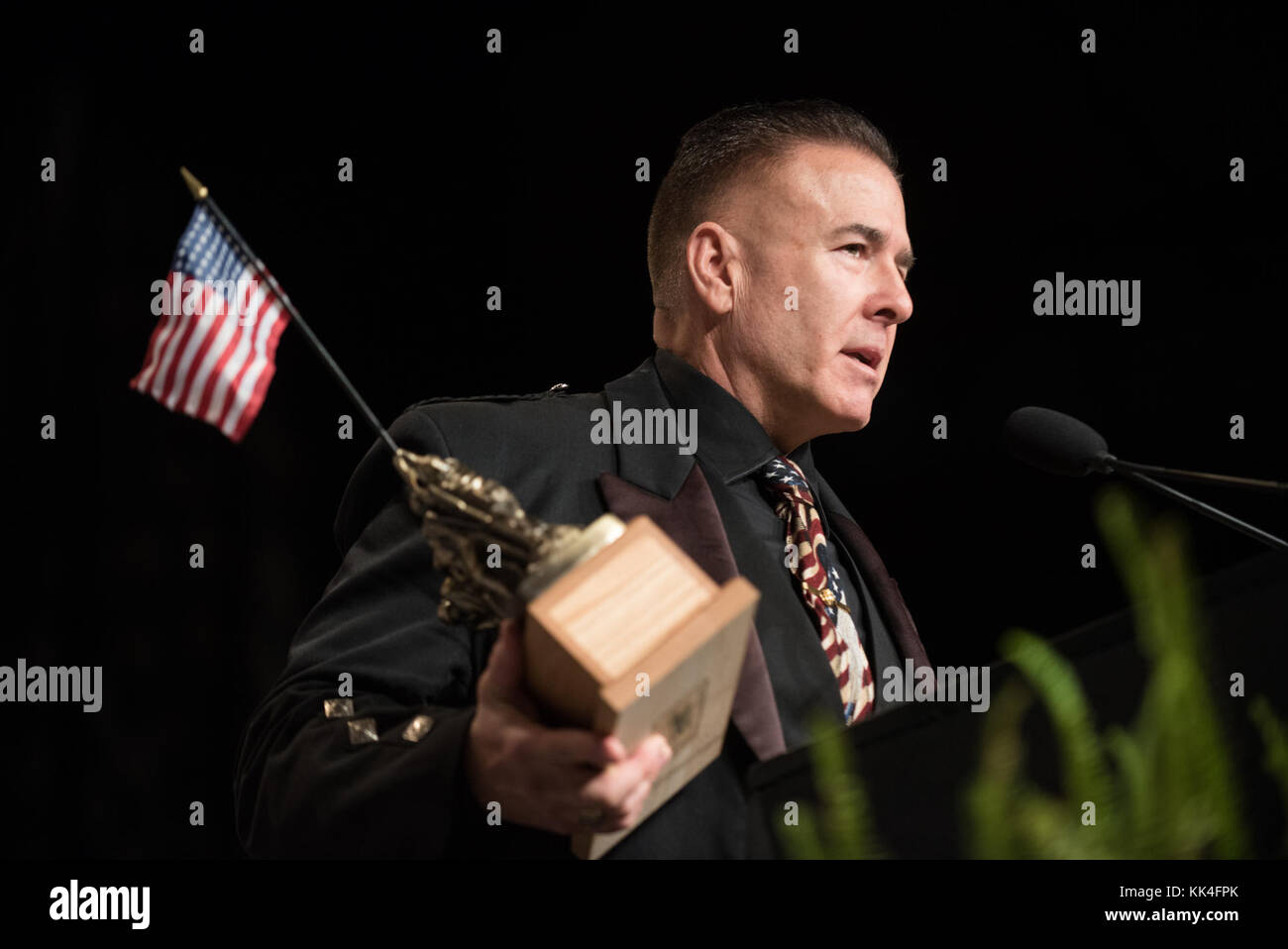 Former U.S. Marine Sgt. Dan Clark speaks after being presented the Lt. Col. William F. Degan Semper Fidelis Award - Stock Image