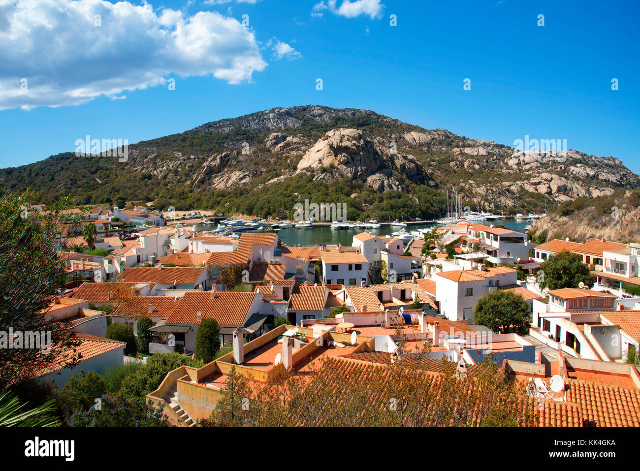 a panoramic view of Poltu Quatu, in the famous Costa Smeralda, Sardinia, Italy, with its marina in the background - Stock Image