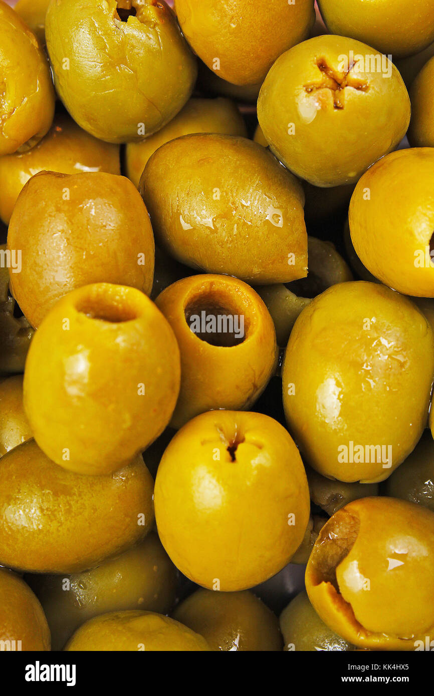 Olives. Green fresh olive textute pattern closeup photo as background. Olives backdrop closeup photo. - Stock Image