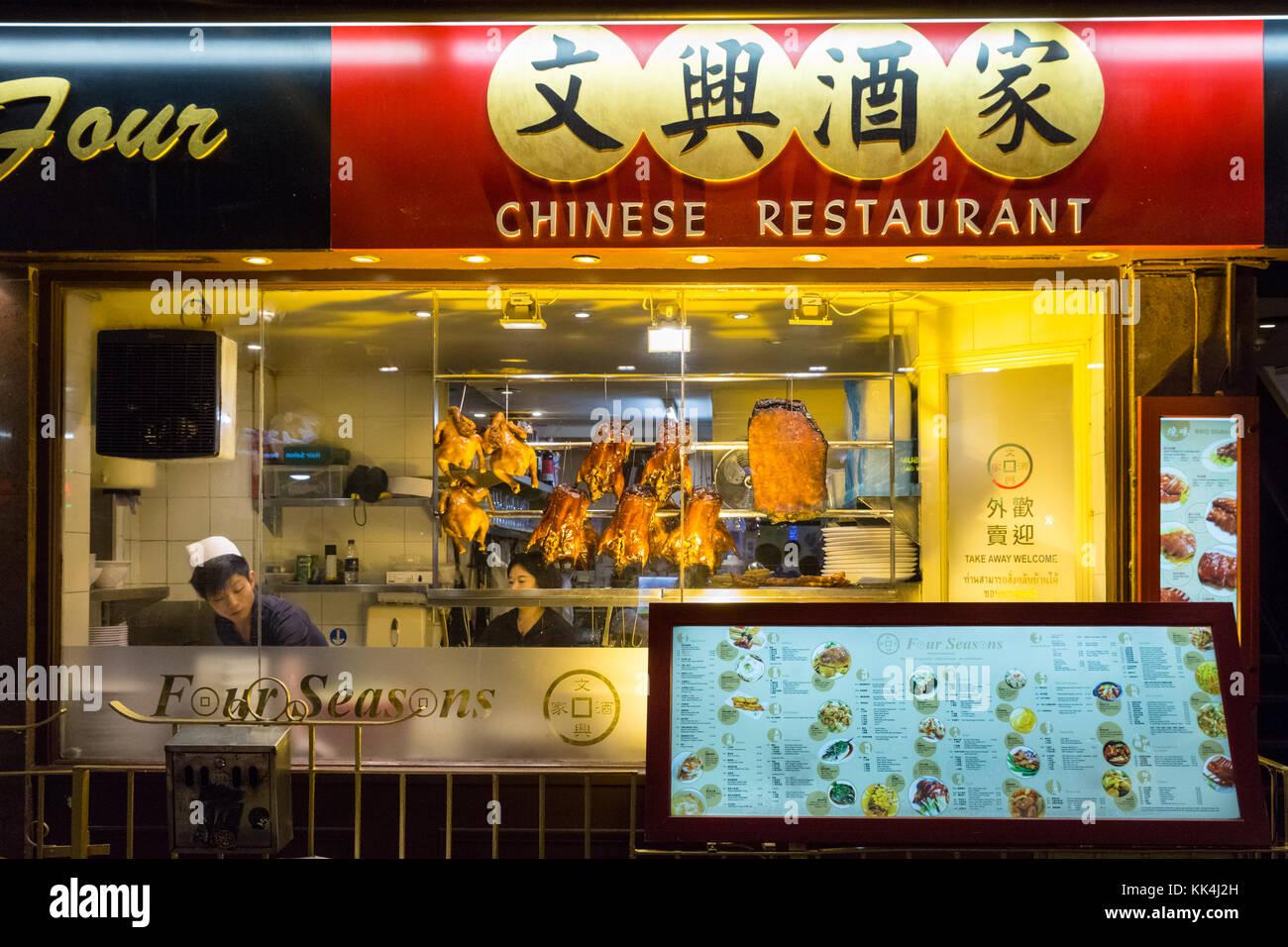 Crispy duck Chinese food display in Chinese restaurant window, Chinatown, London UK - Stock Image