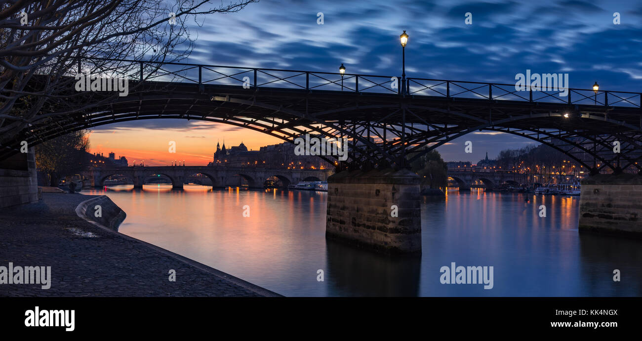 Sunrise on the Seine River with Pont des Arts and Pont Neuf. Ile de la Cite, 1st Arrondissement, Paris, France - Stock Image