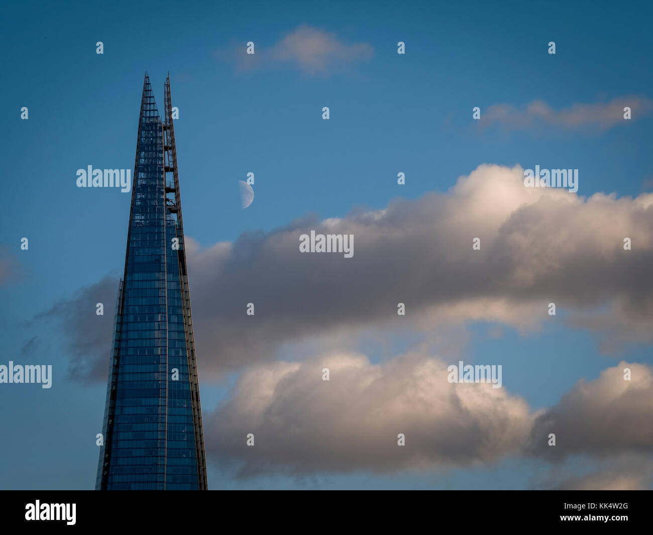 Moon rising over The Shard Building, London, Britain - Stock Image