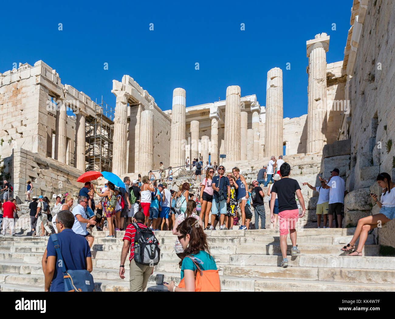 Crowds of tourists on the steps leading up to the Propylaea, Acropolis, Athens, Greece Stock Photo