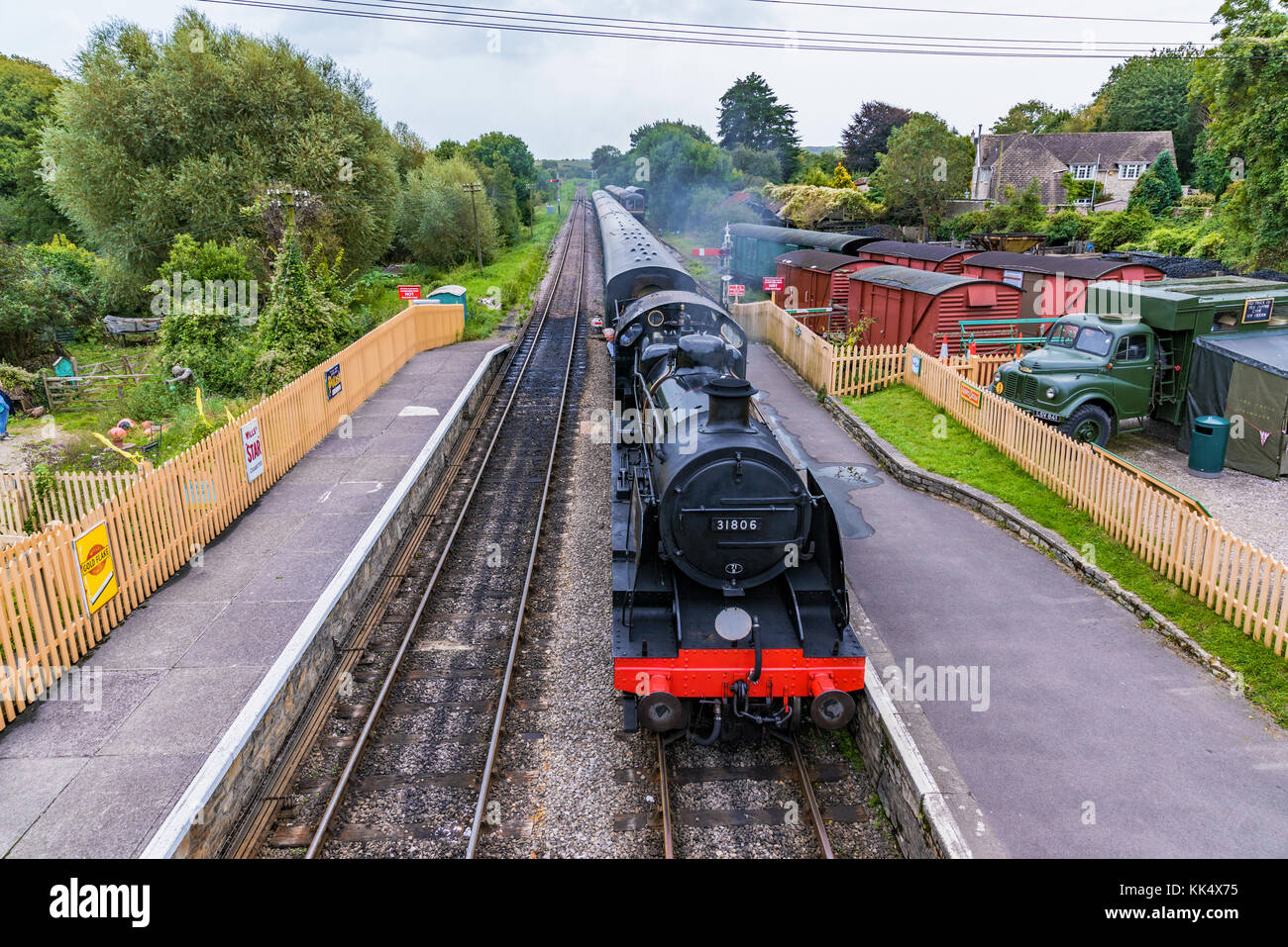 CORFE, UNITED KINGDOM - SEPTEMBER 08: This is an old British steam train passing through the medieval village of - Stock Image