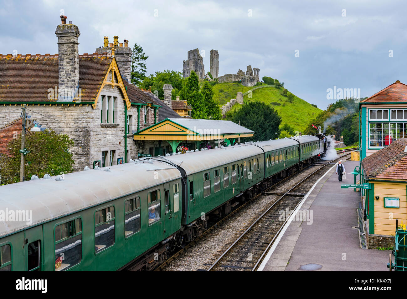 CORFE, UNITED KINGDOM - SEPTEMBER 06: This is a view of Corfe Castle railway station with an old steam train passing - Stock Image
