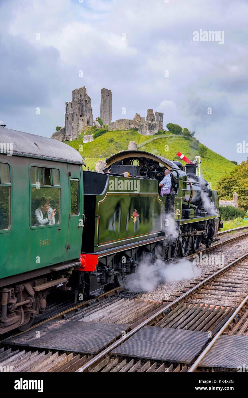 CORFE, UNITED KINGDOM - SEPTEMBER 06: This is a traditional British steam train passing through the medieval town Stock Photo