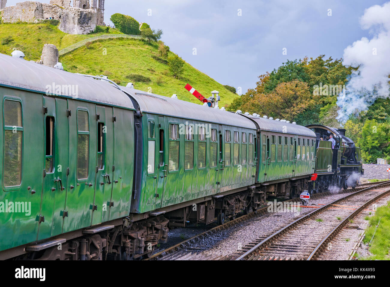 CORFE, UNITED KINGDOM - SEPTEMBER 06: This is a traditional British steam train passing through the medieval town - Stock Image