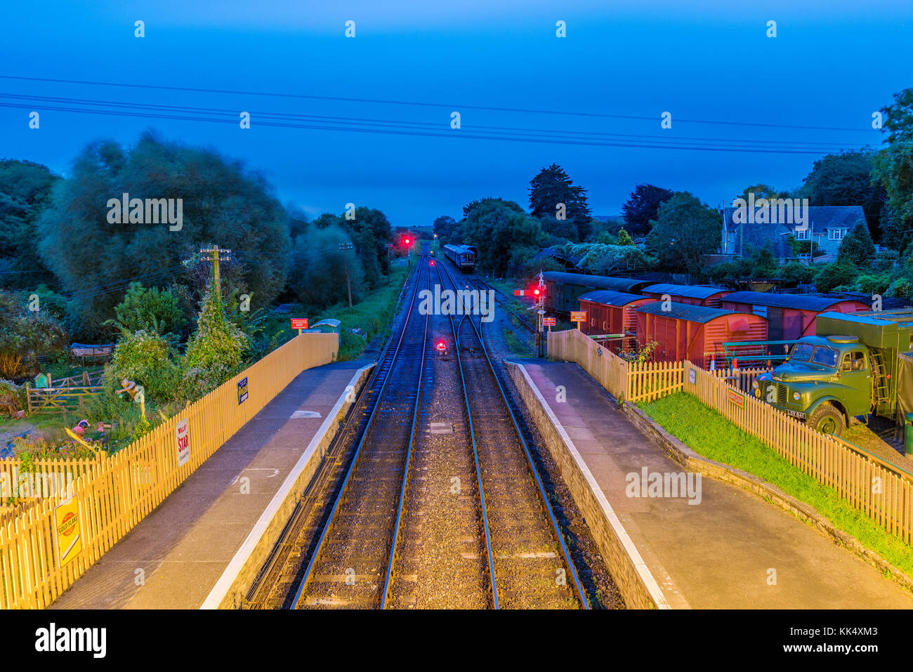 CORFE, UNITED KINGDOM - SEPTEMBER 08: Train tracks and train yard at night in Corfe Castle railway station on September - Stock Image