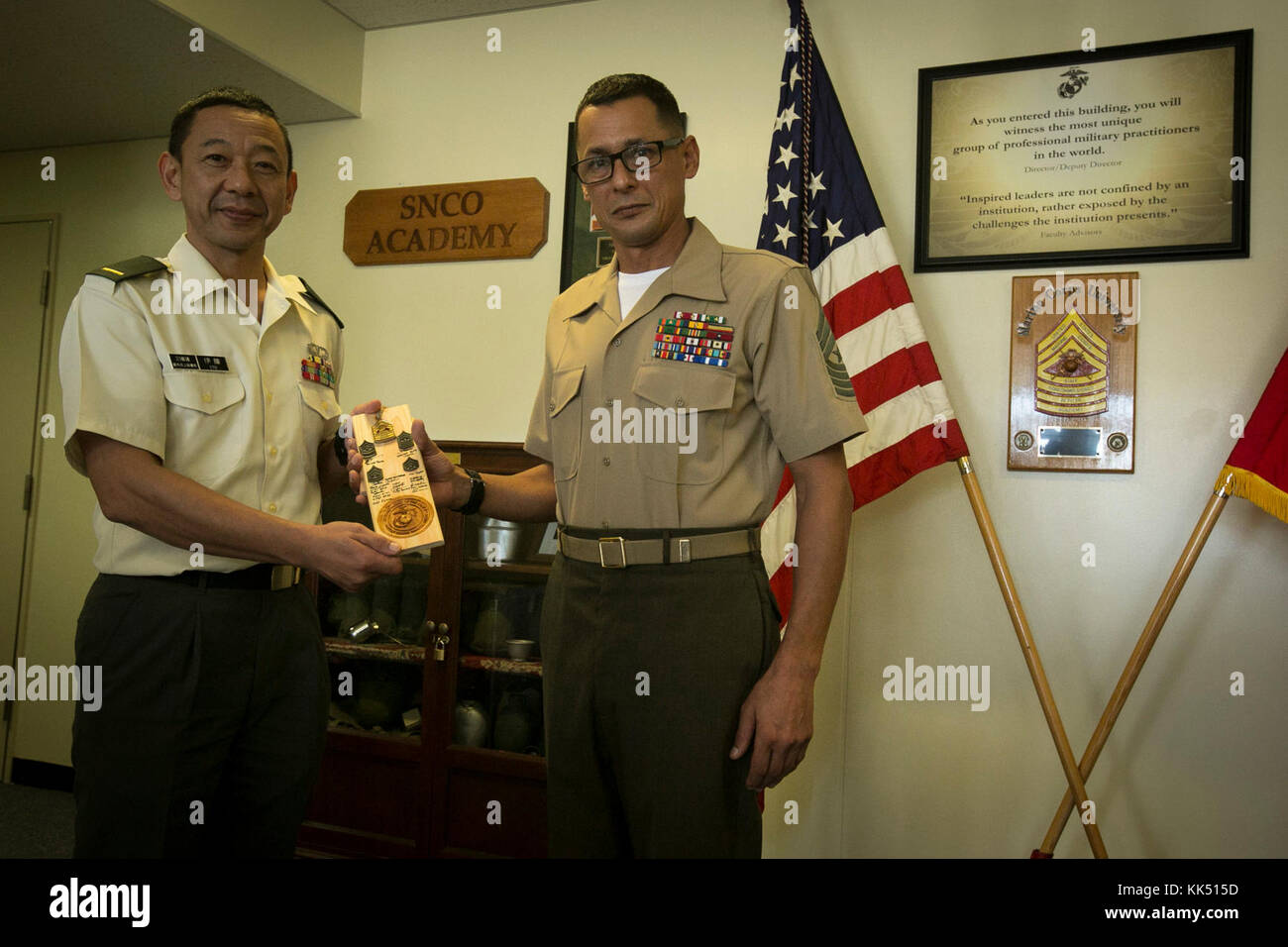 U.S. Marine Sgt. Maj. Michael S. Payne, the Staff Noncommissioned Officer Academy director, presents a gift to Japan Stock Photo
