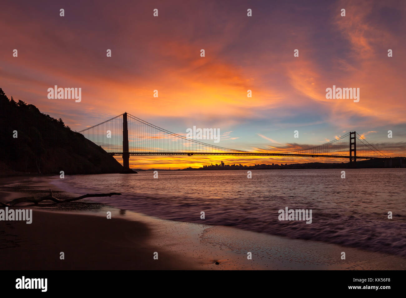 Golden Gate Bridge and San Francisco at dawn viewed from Kirby Cove. - Stock Image