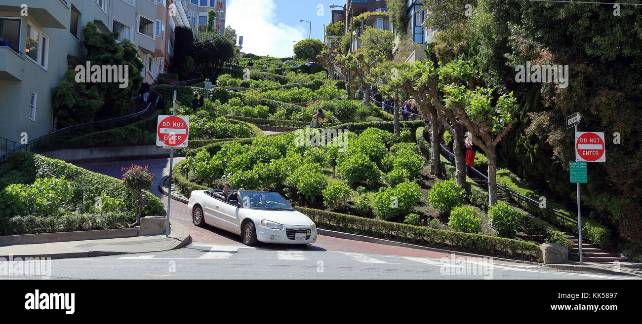 A car is coming down famous Lombard street. - Stock Image