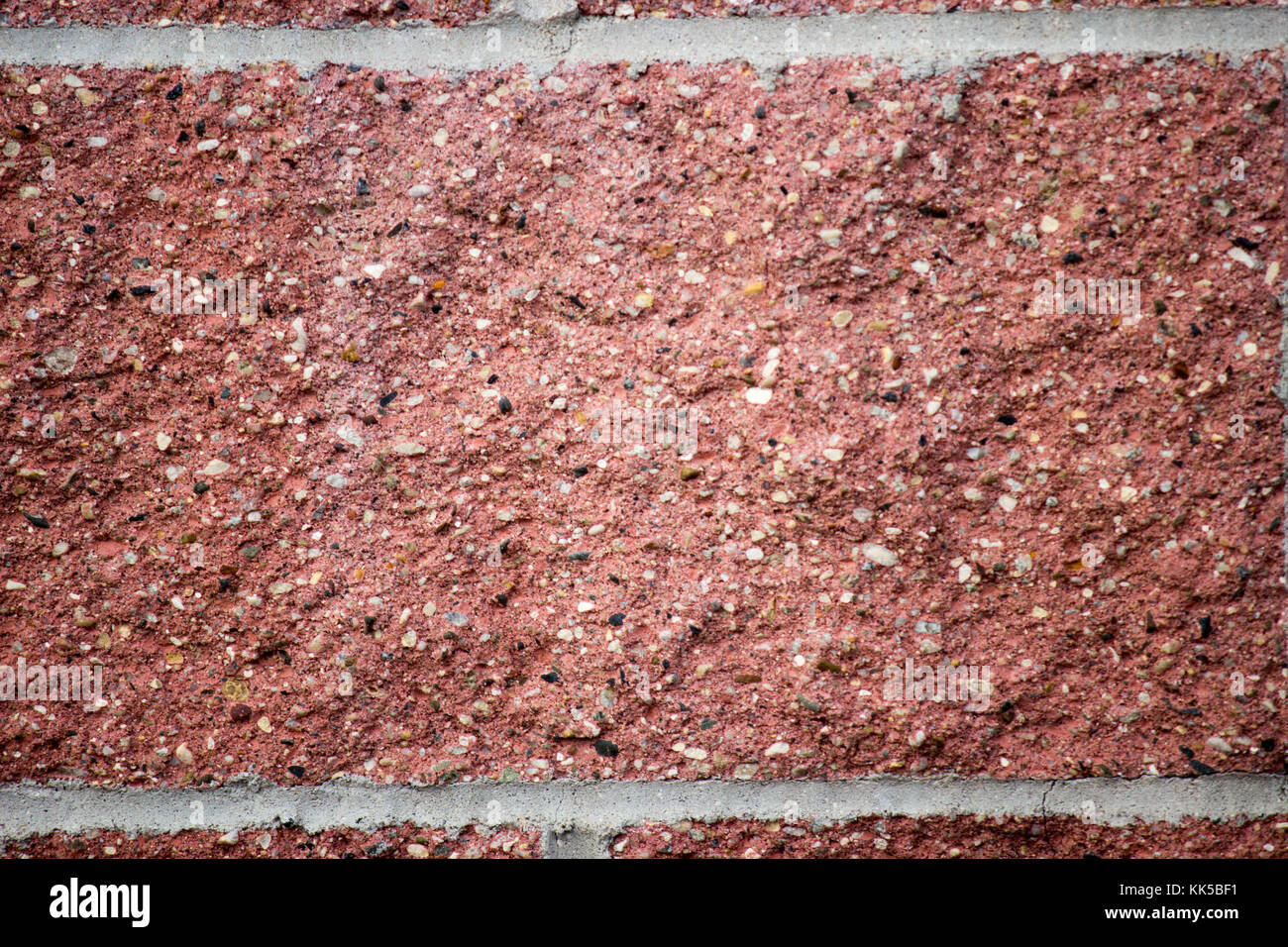 close up detail of red brick or stone and white mortar - Stock Image