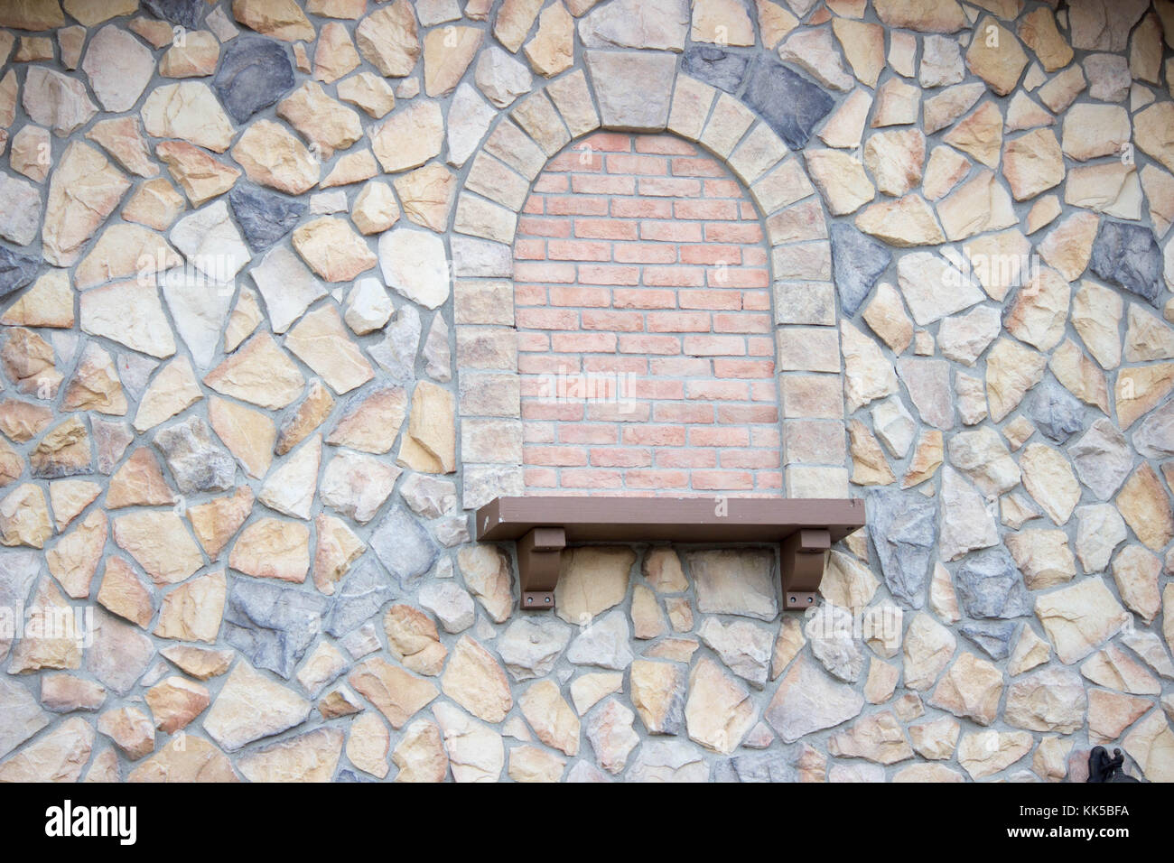 close up detail of large rock texture and cement on building - Stock Image