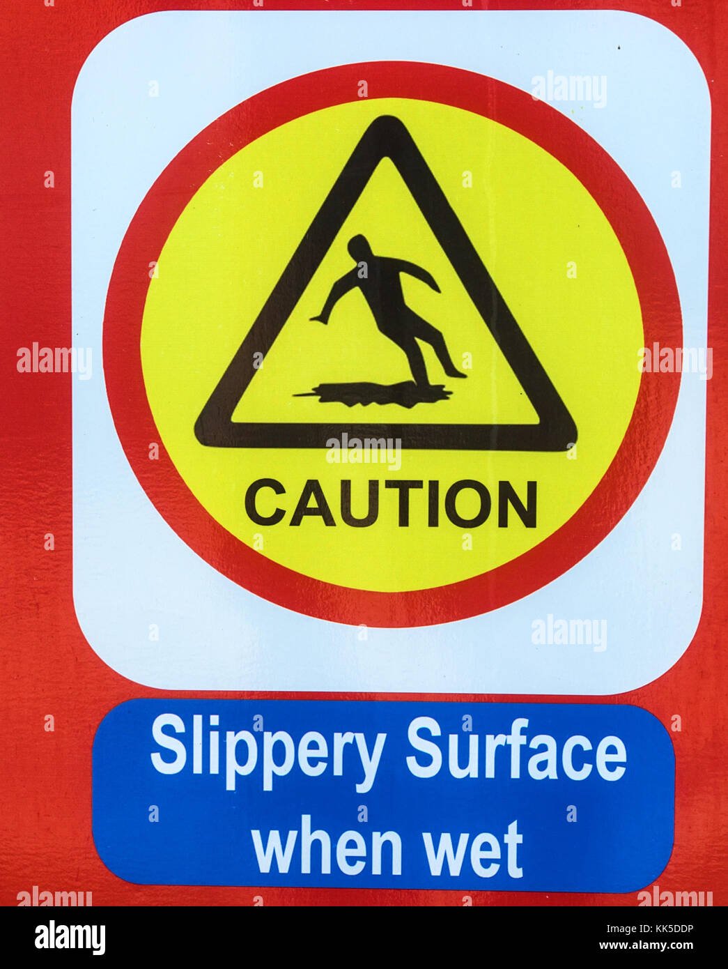 Bright yellow and red sign of slippery surface Stock Photo
