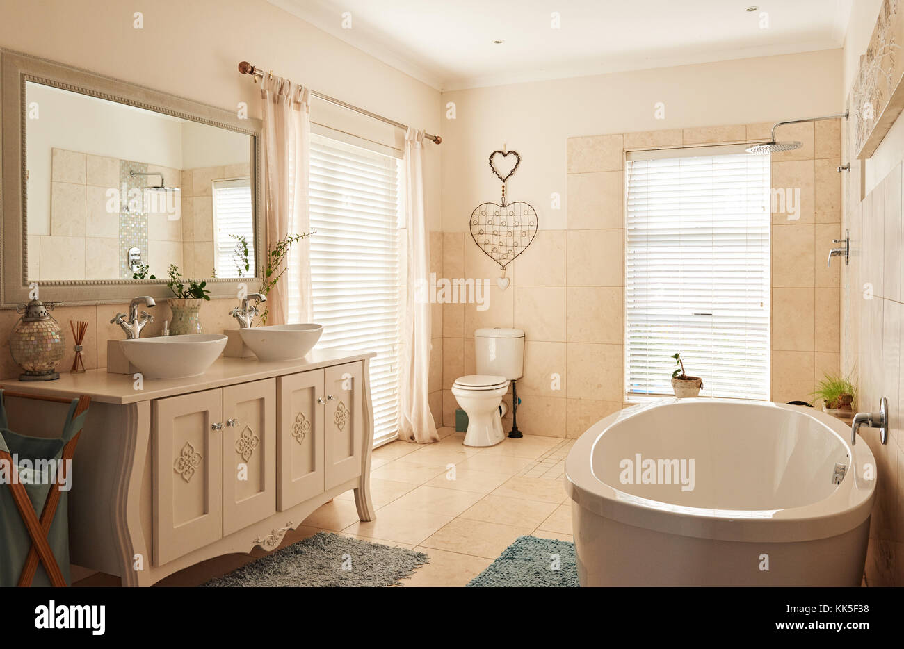 Interior of a spacious classically styled bathroom - Stock Image