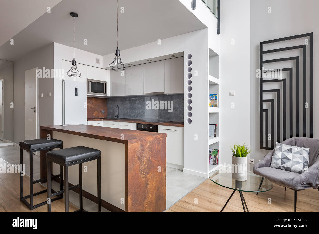Apartment With Functional Open Kitchen And Modern Wall Radiator Stock Photo Alamy