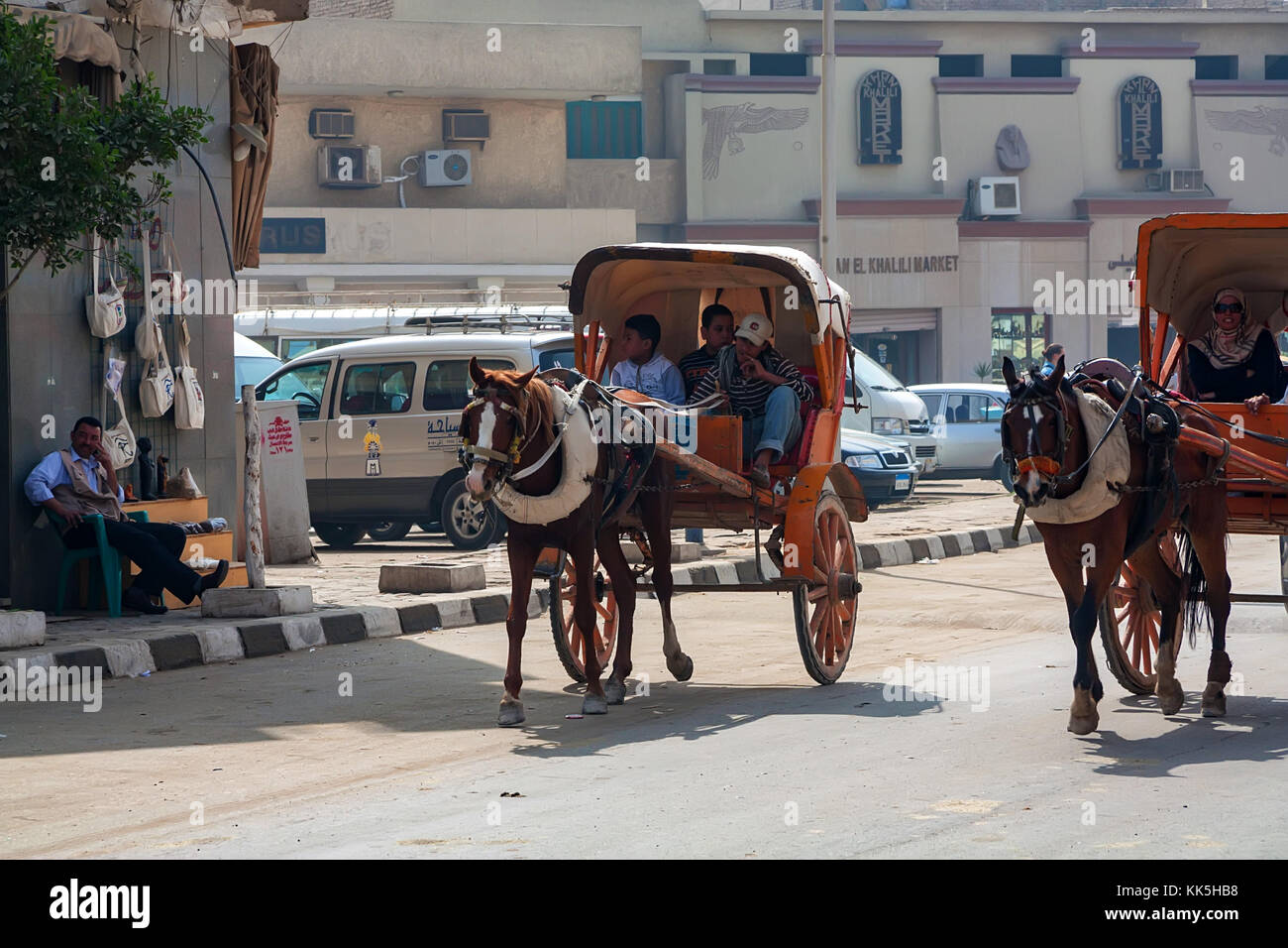 GIZA, EGYPT - FEBRUARY 2010: Horse carriages on city street Stock Photo