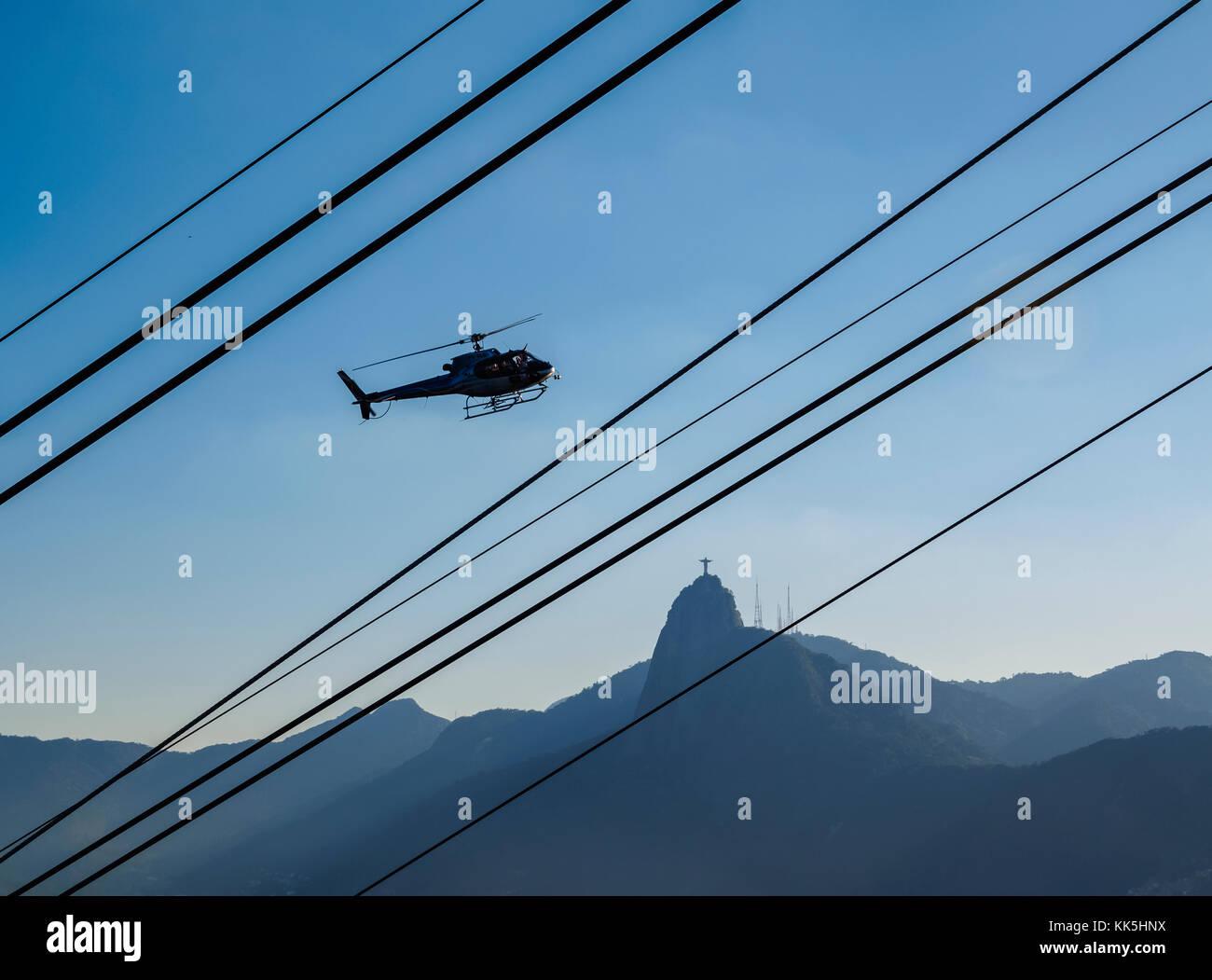 Helicopter and Corcovado Mountain seen from the Morro da Urca, Rio de Janeiro, Brazil Stock Photo
