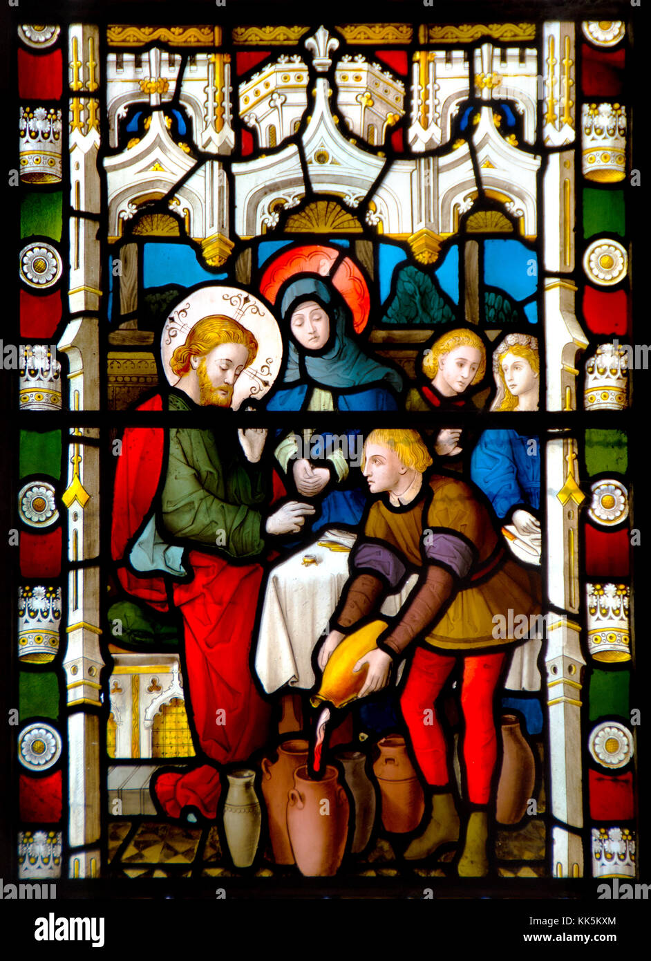 Faversham, Kent, England. St Mary of Charity parish church. Stained glass window: Wedding at Cana - turning water Stock Photo