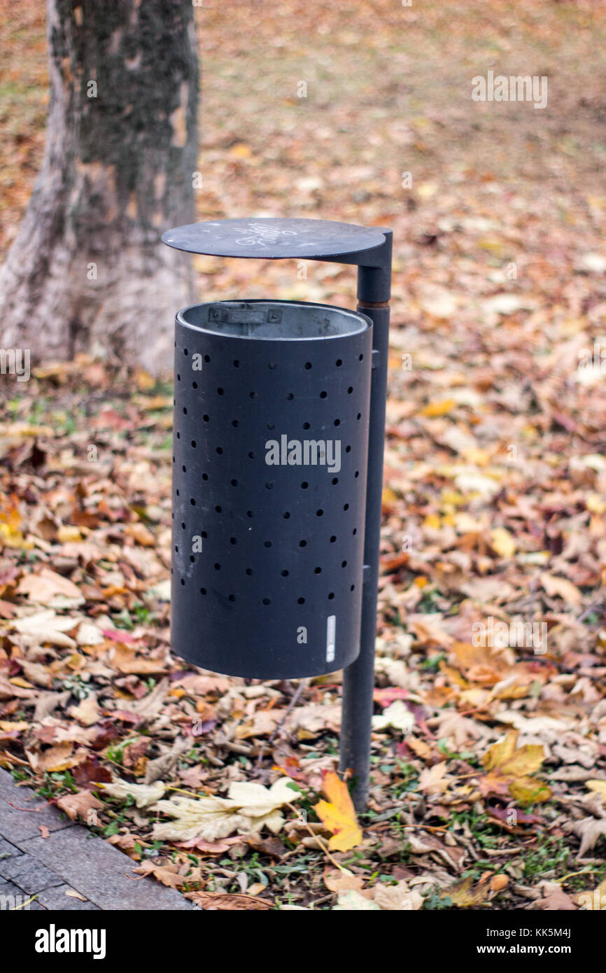 trash can on a park autumn scenery bin recycle scenic - Stock Image