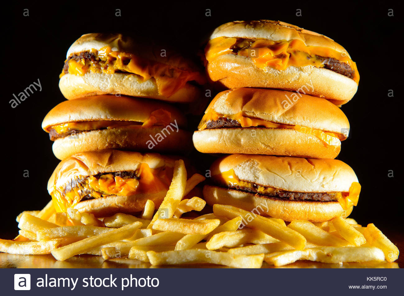 File photo dated 09/07/14 of a pile of cheeseburgers and french fries. Hundreds of thousands of children are watching - Stock Image