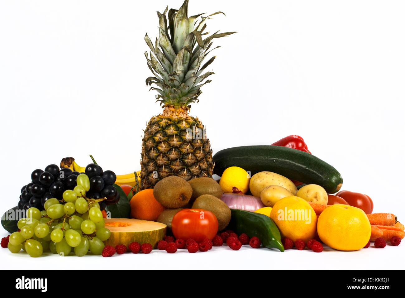 Multi colored vegetables and fruit isolated on white background. - Stock Image