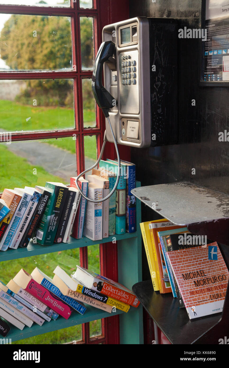 A new use for a British public telephone box, a library, in Athelstaneford East Lothian Scotland. - Stock Image