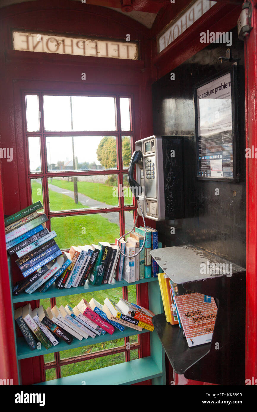 A new use for a British public telephone box, a library, in Athelstaneford East Lothian Scotland. Stock Photo