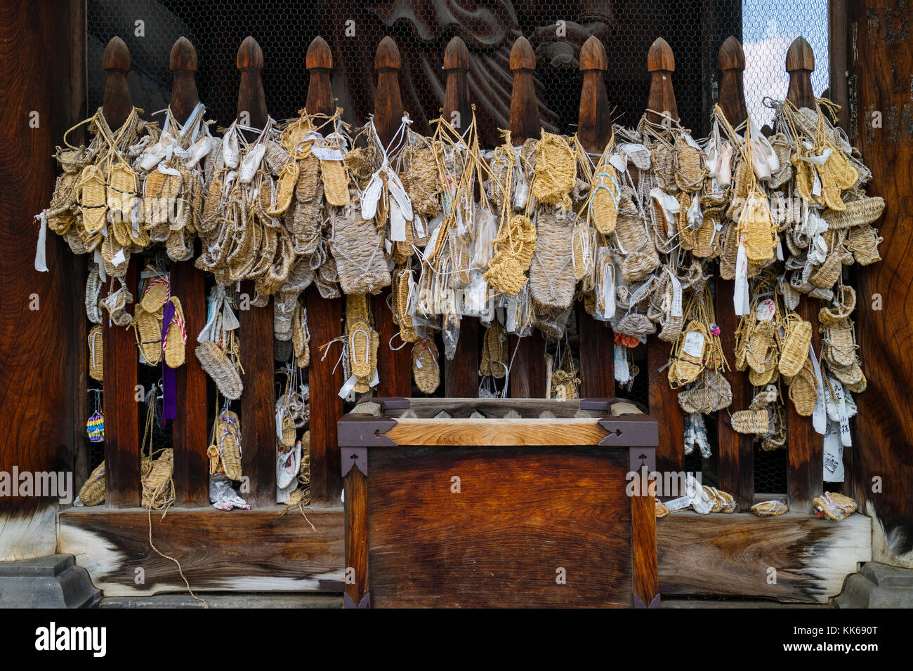 Nagano - Japan, June 3, 2017:  Waraji or traditional straw sandals hung as offerings on the Niomon Gate to the important - Stock Image