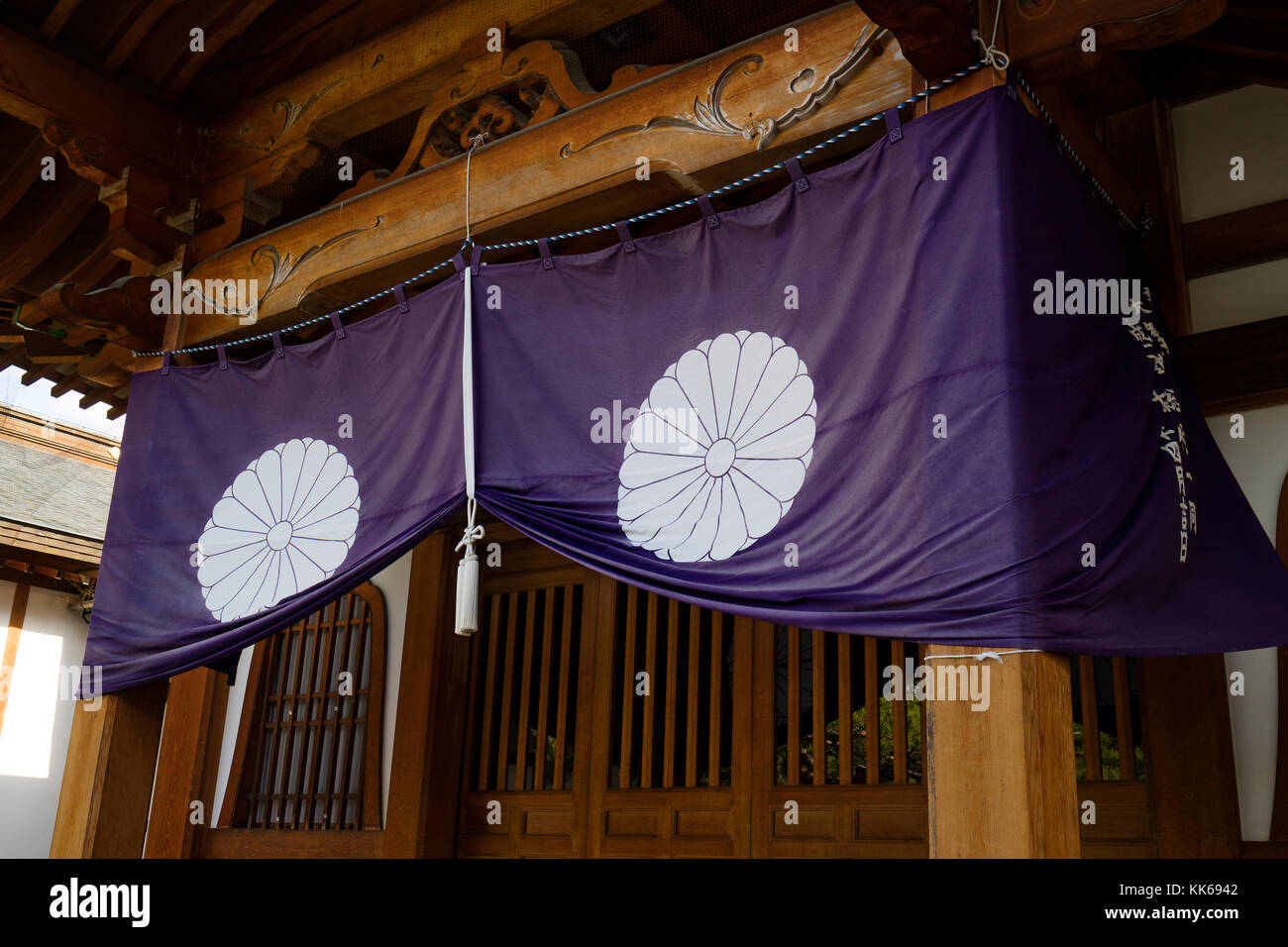 Nagano - Japan, June 3, 2017: Purple temple curtain with a white knot at the Buddhist Zenkoji temple in Nagano - Stock Image