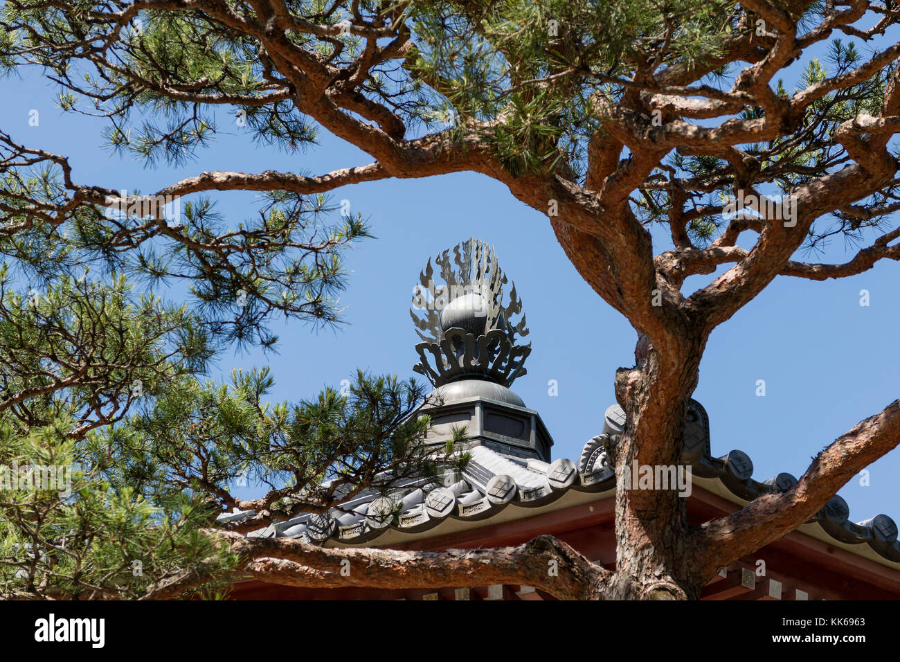 Nagano - Japan, June 5, 2017:  Roof ornament of the Scripture House, Kyozo at the Buddhist Zenkoji temple in Nagan - Stock Image