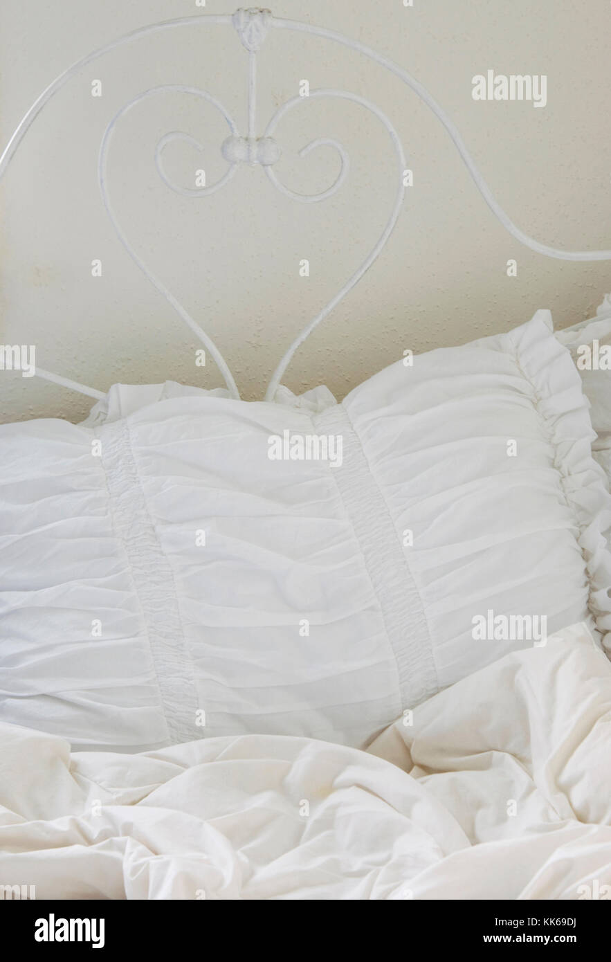 An image of a white bed - Stock Image