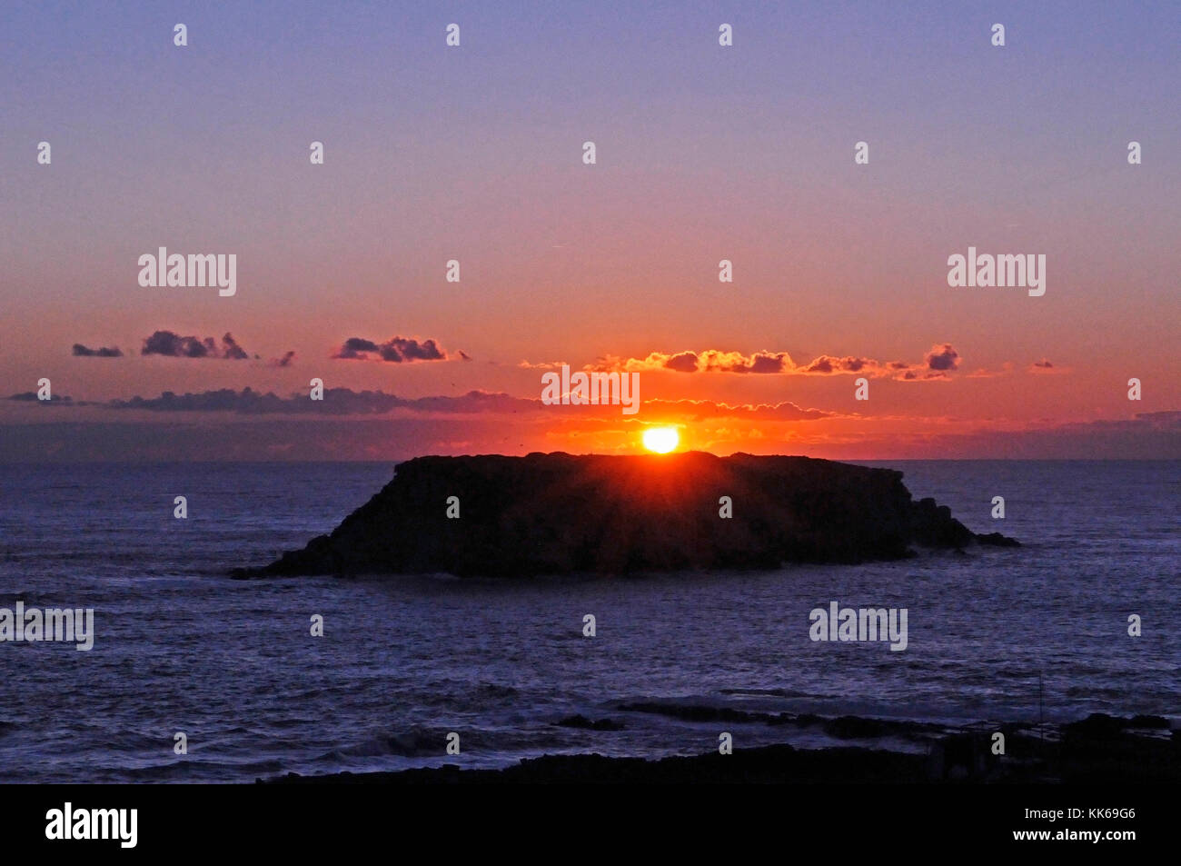Sunset View to the offshore island at Agios Georgios  Cape Drepano Paphos Cyprus - Stock Image