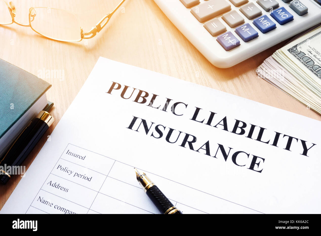 Public liability insurance policy on an office desk. - Stock Image