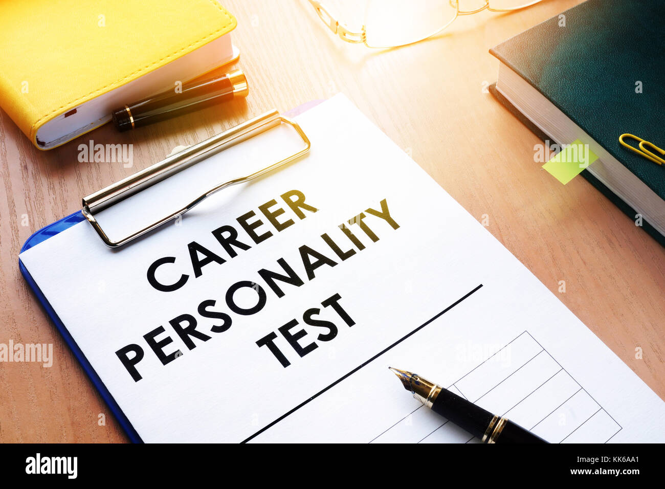 Clipboard with Career personality test on an office desk. Assessments concept. - Stock Image