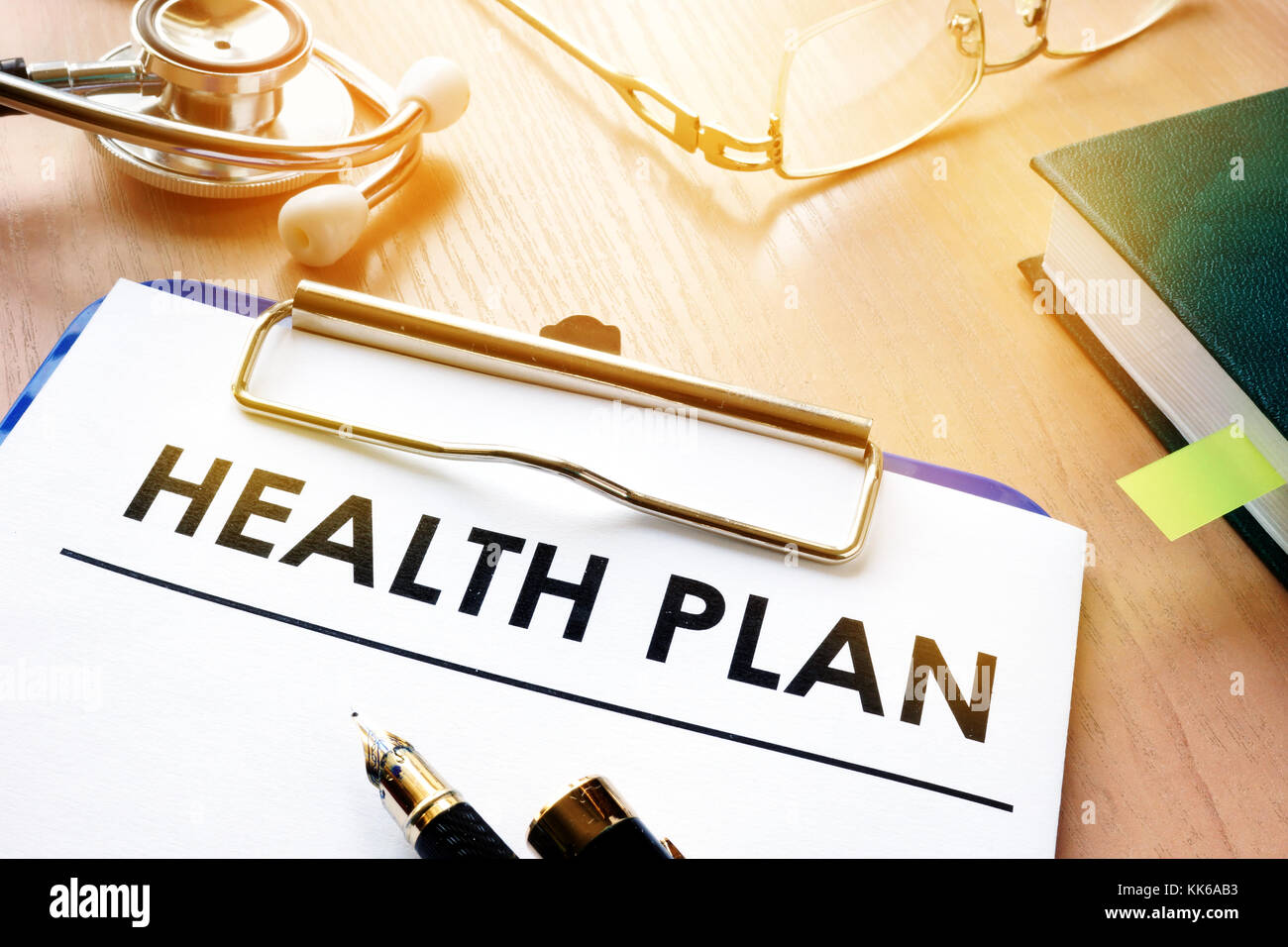 Clipboard with health plan and stethoscope. - Stock Image