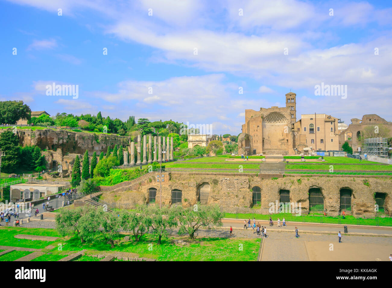 View of Roman ruins, columns and reconstructions of the Old City in Rome with many tourists. - Stock Image