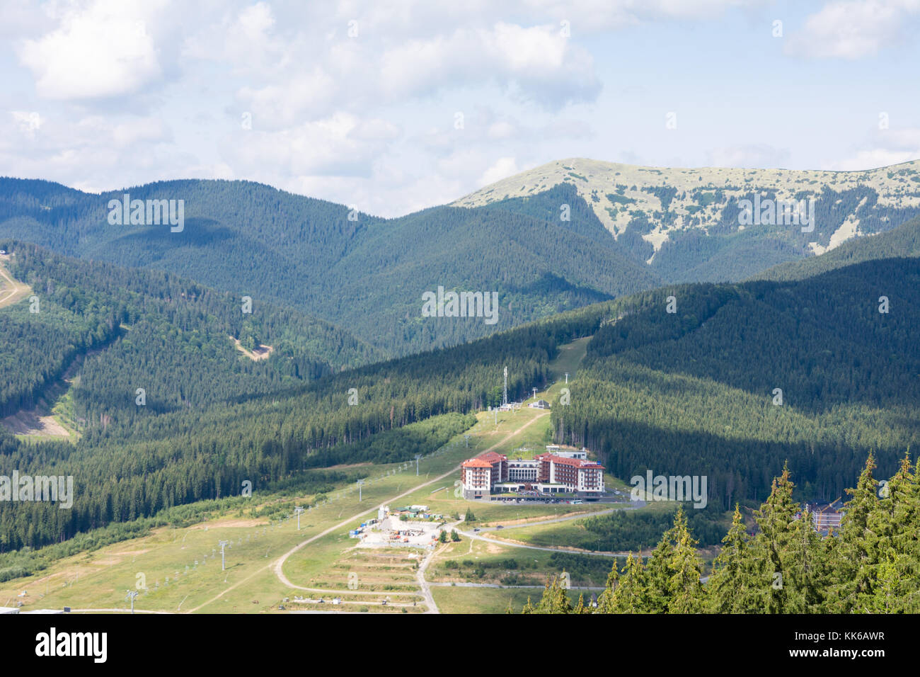 Mountains of the Carpathians against the blue sky covered with greenery resort - Stock Image