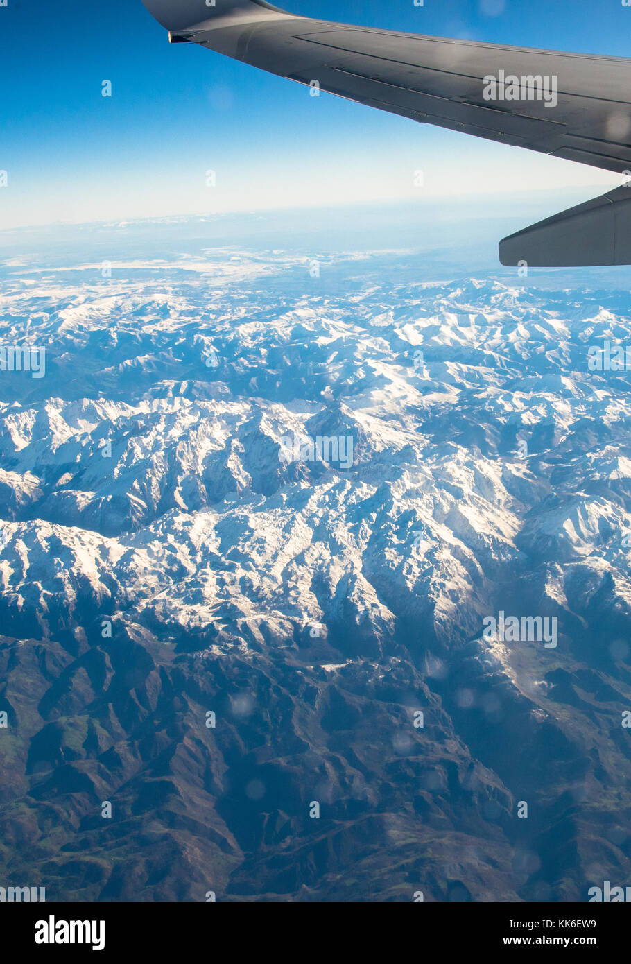 view from airoplane to snowcovered Pyrenees - Stock Image